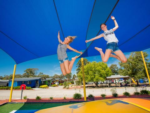 BIG4 Bendigo Park Lane Holiday Park - Jumping Cushion - 2 girls jumping