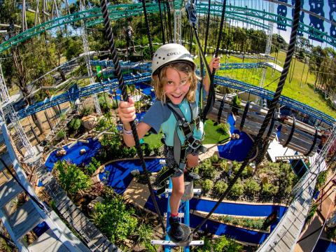 BIG4 Traralgon Park Lane Holiday Park - Parky's Fun Park - Boy on Adventure Rope Course